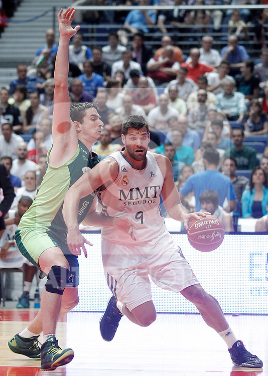 Real Madrid's Felipe Reyes (r) and Unicaja's Carlos Suarez during Liga Endesa ACB Semifinal match.June 6,2014. (ALTERPHOTOS/Acero)