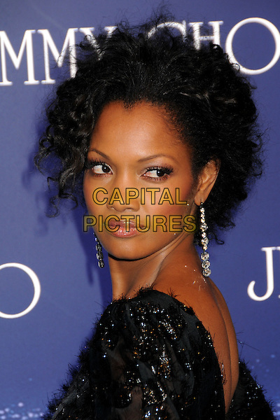 GARCELLE BEAUVAIS-NILON.Jimmy Choo for H&M Launch Party held at a Private Residence, West Hollywood, California, USA..November 2nd, 2009.headshot portrait black beads beaded dangling earrings silver diamonds looking over shoulder .CAP/ADM/BP.©Byron Purvis/AdMedia/Capital Pictures.