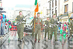 Tommy Martin Castleisland carries the tricolour for the army as they marched in the rain at the Killarney St Patricks day parade