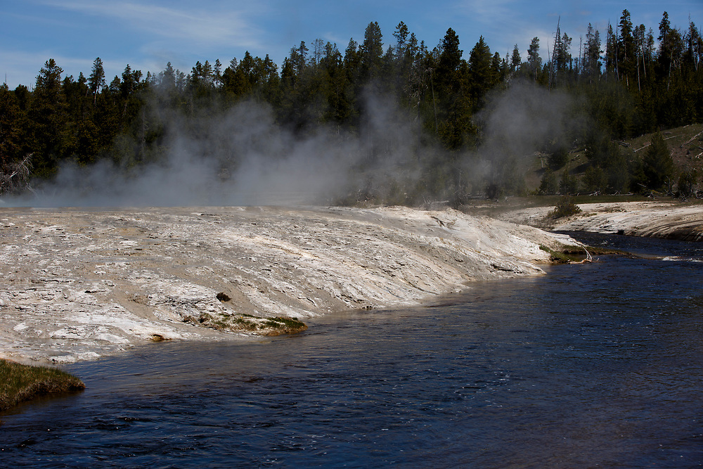 A geothermal feature is pictured along the Firehole River in the Upper Geyser Basin in Yellowstone National Park, Wyoming on Tuesday, May 23, 2017. (Photo by James Brosher)