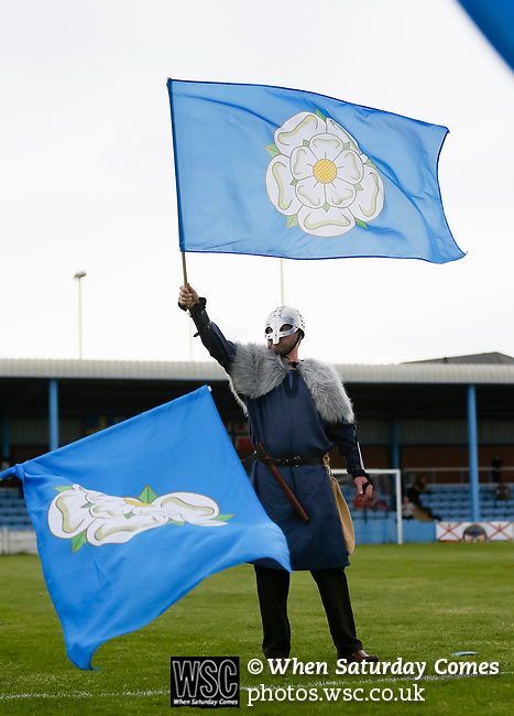 Ragnar the Viking, Yorkshire's mascot waving the Yorkshire flag. Yorkshire v Parishes of Jersey, CONIFA Heritage Cup, Ingfield Stadium, Ossett. Yorkshire's first competitive game. The Yorkshire International Football Association was formed in 2017 and accepted by CONIFA in 2018. Their first competative fixture saw them host Parishes of Jersey in the Heritage Cup at Ingfield stadium in Ossett. Yorkshire won 1-0 with a 93 minute goal in front of 521 people. Photo by Paul Thompson