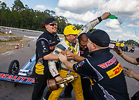 Mar 18, 2018; Gainesville, FL, USA; NHRA top fuel driver Richie Crampton celebrates with his crew after winning during the Gatornationals at Gainesville Raceway. Mandatory Credit: Mark J. Rebilas-USA TODAY Sports