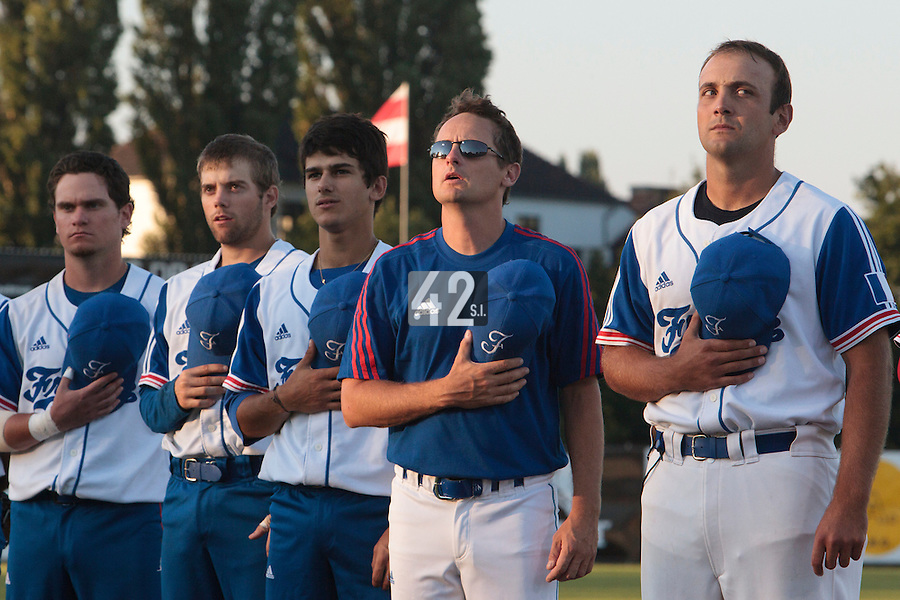 21 August 2010: Jean-Michel Mayeur of Team France stands during the national anthem, next to Rodolphe Le Meur, Maxime Lefevre, Sebastien Duchossoy, Jorge Hereaud, prior to Russia 13-1 win in 7 innings over France, at the 2010 European Championship, under 21, in Brno, Czech Republic.