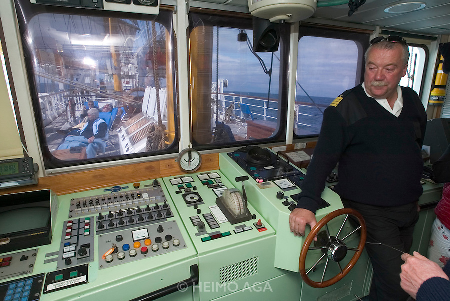 "Captain Axel Rittig touring the ""Lili Marleen"" (luxurious sailing ship of Deilmann Cruises) with passengers..The bridge."