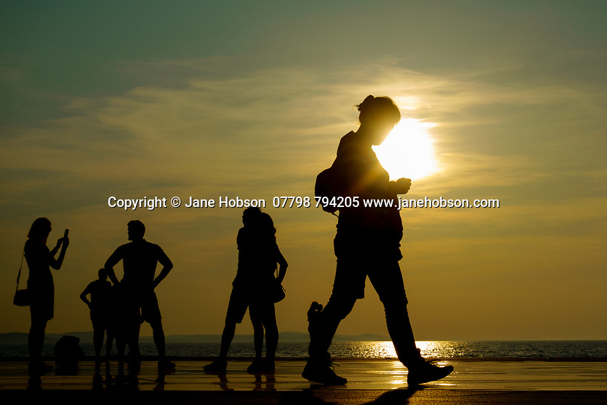 Zadar, Croatia. 26.05.2018. Tourists at the Greeting to the Sun, Zadar, Croatia. Photograph © Jane Hobson.