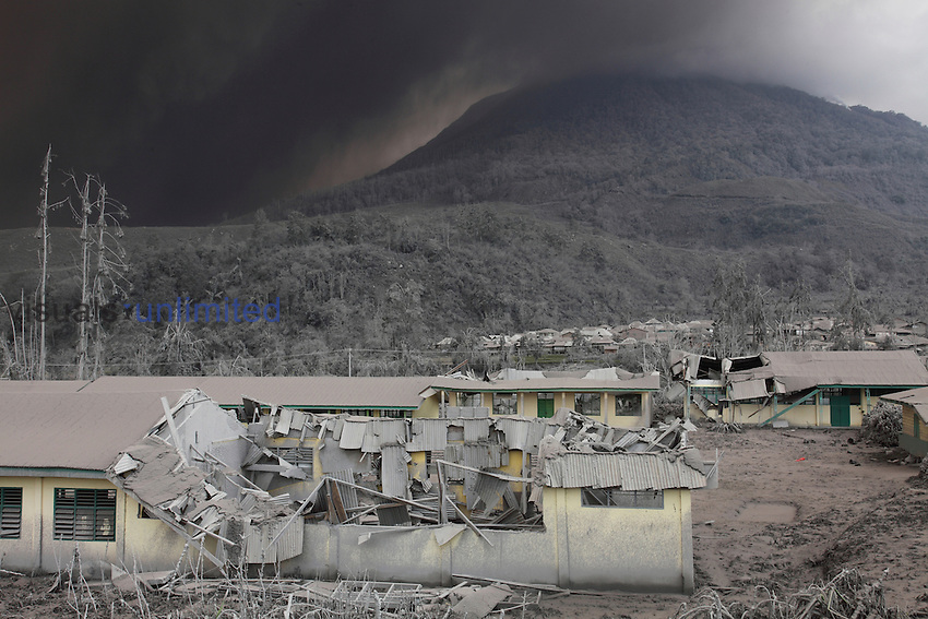 School buildings with collapsed roofs due to heavy ash fall from eruption of Sinabung Volcano, Indonesia