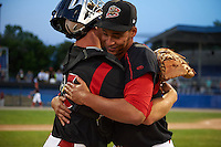 Batavia Muckdogs starting pitcher Gabriel Castellanos hugs catcher Korey Dunbar (43) after a game against the Mahoning Valley Scrappers on June 24, 2015 at Dwyer Stadium in Batavia, New York.  Batavia defeated Mahoning Valley 1-0 as Castellanos, Brett Lilek and Steven Farnworth combined on the organizations first perfect game in team history.  (Mike Janes/Four Seam Images)