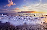 Sunset on Maui, Hawaii beach with Molokai in background.