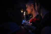 NEW YORK JUNE 13: A woman holds a candle outside Manhattan's historic Stonewall Inn to express their support for the victims killed at Pulse nightclub in Orlando. New York June 13, 2016 Photo by VIEWpress/Maite H. Mateo.