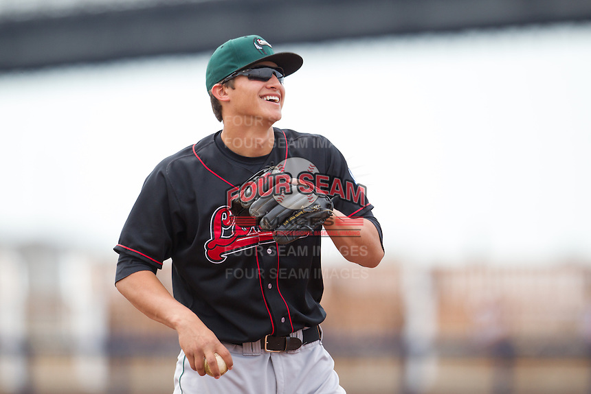 Great Lakes Loons infielder Corey Seager #12 throws during a game against the Quad Cities River Bandits at Modern Woodmen Park on April 29, 2013 in Davenport, Iowa. (Brace Hemmelgarn/Four Seam Images)