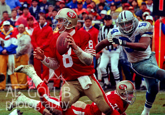 San Francisco 49ers vs. Dallas Cowboys at Candlestick Park Sunday, January 17,1993.  Cowboys beat 49ers 30-20.  Dallas Cowboys defensive end Charles Haley (94) pursues San Francisco 49ers quarterback Steve Young (8).  (