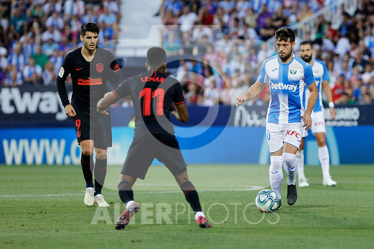 CD Leganes's Jose Arnaiz and Atletico de Madrid's Thomas Lemar during La Liga match between CD Leganes and Atletico de Madrid at Butarque Stadium in Madrid, Spain. August 25, 2019. (ALTERPHOTOS/A. Perez Meca)