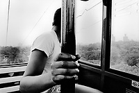 USA. New York. Bronx zoo. Richie, a young black Puerto Rican teenager from Spanish Harlem seats in a cable car travelling above the zoo. 24.07.86 © 1986 Didier Ruef