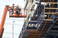Workers on Manlift, East Deck Casting, New Pearl Harbor Memorial Bridge under Construction at New Haven Harbor Crossing, Connectictut. CONNDOT Contract B, Project #92-618. When complete the alternately named Quinnipiac River Bridge will be first Extradosed Engineered & Designed Bridge in the United States.
