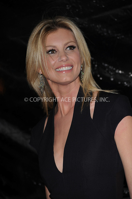 WWW.ACEPIXS.COM . . . . . ....November 17 2009, New York City....Musician Faith Hill arriving at the premiere of 'The Blind Side' at the Ziegfeld Theatre on November 17, 2009 in New York City.....Please byline: KRISTIN CALLAHAN - ACEPIXS.COM.. . . . . . ..Ace Pictures, Inc:  ..tel: (212) 243 8787 or (646) 769 0430..e-mail: info@acepixs.com..web: http://www.acepixs.com