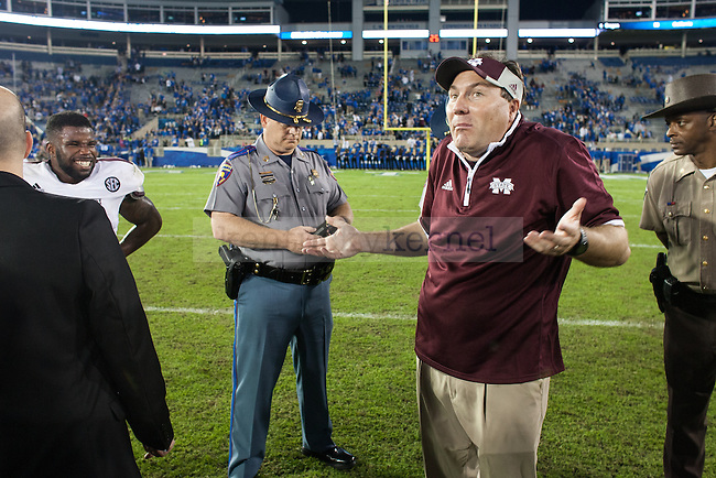 Mississippi head coach Dan Mullen shrugs after the second half of the Kentucky Wildcats game against the Mississippi State Bulldogs at Commonwealth Stadium on Saturday, October 25, 2014 in Lexington, Ky. Mississippi State defeated Kentucky 45-31. Photo by Adam Pennavaria | Staff