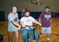 Elizabeth Holloway from Valley Park and Caleb Hill from Oak Vale, both senior kinesiology majors, help Bulldog Bike Camp participant Debra Ann Breazeale in the Joe Frank Sanderson Center. Mississippi State's kinesiology program hosted the camp May 23-27 in cooperation with ICan Shine, a nonprofit charity that conducts physical activity skills camps nationwide to assist children and adults with special needs.<br />