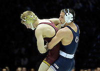 STATE COLLEGE, PA - JANUARY 25: Nick Wanzek of the Minnesota Golden Gophers and Garett Hammond of the Penn State Nittany Lions during their match on January 25, 2015 at Recreation Hall on the campus of Penn State University in State College, Pennsylvania. Minnesota won 17-16. (Photo by Hunter Martin/Getty Images) *** Local Caption *** Nick Wanzek;Garett Hammond