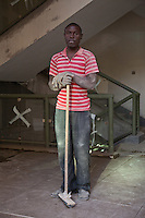 A mason at work in Nairobi, Kenya. He is part of a construction crew working to finish The Greenhouse, a retail and office development.