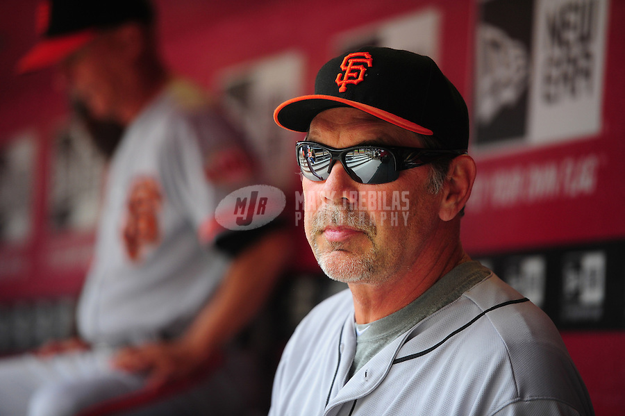 Apr. 8, 2012; Phoenix, AZ, USA; San Francisco Giants manager Bruce Bochy in the dugout in the first inning against the Arizona Diamondbacks at Chase Field. Mandatory Credit: Mark J. Rebilas-
