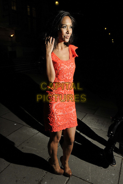 Myleene Klass.The talent agent Jonathan Shalit's 50th birthday party, V&A Museum, Cromwell Rd., London, England..April 17th, 2012.full length pink red lace dress hand arm.CAP/CAN.©Can Nguyen/Capital Pictures.