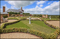BNPS.co.uk (01202 558833)<br /> Pic:  KnightFrank/BNPS.<br /> <br /> Formal garden.<br /> <br /> A stunning new Arts and Crafts style country manor which comes with its own lake, swimming pool, tennis court and summer house has come on to the market for £4.95million.<br /> <br /> Recently built Thakeham Manor, which also has a helipad, is set in 16 acres of landscaped parkland near Pulborough, West Sussex.<br /> <br /> Its eye-catching design, inspired by the famous early 20th century architect Edwin Lutyens, includes a slate roof, stone quoins and brick buttresses, while inside it is full of glamorous modern touches.<br /> <br /> The luxurious property has five bedrooms, five bathrooms and six reception rooms, and its grounds contain a heated swimming pool and decking area, a circular cushioned seating area and a tennis court.
