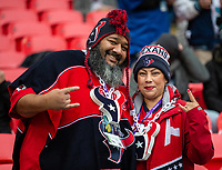 3rd November 2019; Wembley Stadium, London, England; National Football League, Houston Texans versus Jacksonville Jaguars; A couple of Texan fans in the crowd - Editorial Use