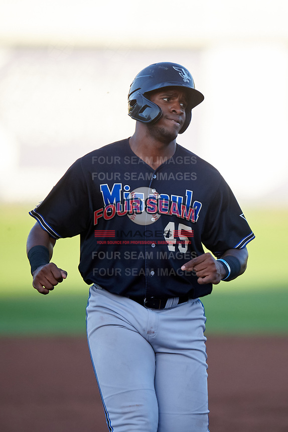 Missoula Osprey Francis Martinez (45) jogs toward third base during a Pioneer League game against the Idaho Falls Chukars at Melaleuca Field on August 20, 2019 in Idaho Falls, Idaho. Idaho Falls defeated Missoula 6-3. (Zachary Lucy/Four Seam Images)