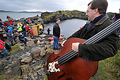 a band joined in complete with double bass - at the World Stone Skimming Championships which attracted over 300 entries from all round the world - Easdale is reached by a small open ferry-boat from the Isle of Seil - south of Oban - picture by Donald MacLeod - 25.9.11 - clanmacleod@btinternet.com 07702 319 738 donald-macleod.com