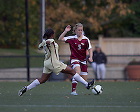 Boston College forward Natalie Crutchfield (9) tackles Florida State defender Eirin Kleppa (5). Florida State University defeated Boston College, 1-0, at Newton Soccer Field, Newton, MA on October 31, 2010.