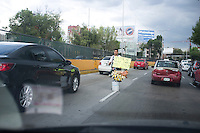 Street Vendors in traffic in the Circuito.  Mexico City