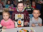 Keila Granickaite, Joy Mooney and Karlos Granickas at Drogheda Library's winter arts and crafts workshop.<br /> <br /> Photo - Jenny Matthews
