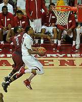 NWA Democrat-Gazette/Michael Woods --02/03/2015--w@NWAMICHAELW... University of Arkansas guard Rashad Madden drives to the hoop past South Carolina defender Marcus Stroman (1) to score in the first half of Tuesday nights game against the South Carolina Gamecocks at Bud Walton Arena in Fayetteville.