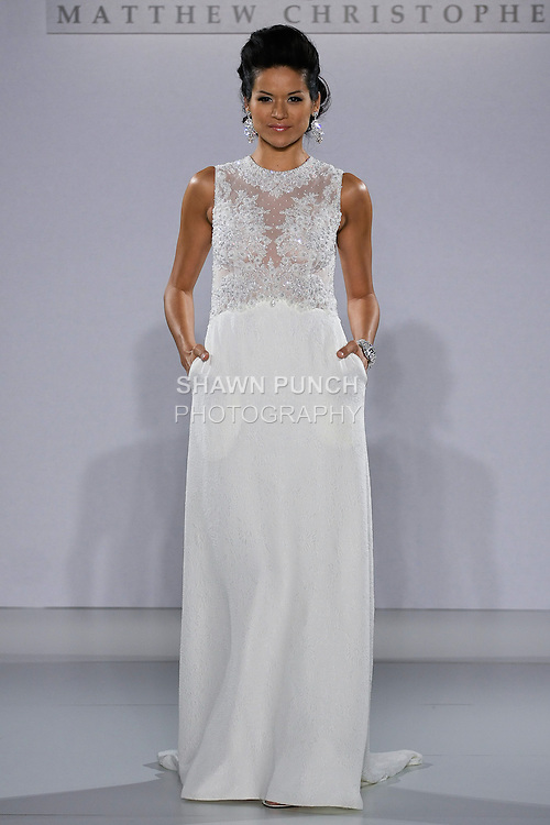 Model walks runway in an Onassis  wedding dress from the Matthew Christopher Couture Spring 2013 collection, at the Couture Show, during New York Bridal Fashion Week Spring 2013.