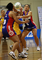 Mystics centre Temepara George (right) competes for the ball during the ANZ Netball Championship match between the Central Pulse and Northern Mystics, TSB Bank Arena, Wellington, New Zealand on Monday, 4 May 2009. Photo: Dave Lintott / lintottphoto.co.nz
