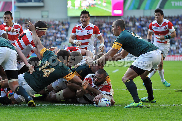 Michael Leitch of Japan reaches for the try-line. Rugby World Cup Pool B match between South Africa and Japan on September 19, 2015 at the Brighton Community Stadium in Brighton, England. Photo by: Patrick Khachfe / Onside Images