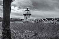 A view of the Doubling Point Lighthouse  over the colorful marsh grass at the rear of keepers house.  Doubling Point Light sits on the Kennebec River in Arrowsic, Maine.