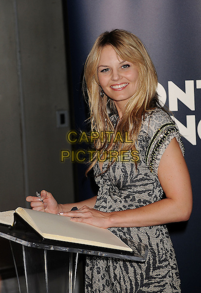 Jennifer Morrison.Montblanc Presents West Coast Debut Of The 24 Hour Plays Held At Pier 59 Studios, Santa Monica, California, USA..June 18th, 2011.half length beige grey gray leopard tiger animal print dress side book pen signing name.CAP/ROT/TM.©Tony Michaels/Roth Stock/Capital Pictures