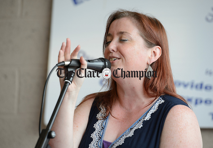 Noirin Lynch  sings at a celebratory concert to thank customers and supporters at the Clare Haven Services shop during Fleadh Cheoil na hEireann in Ennis. Photograph by John Kelly.