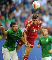 FUSSBALL   1. BUNDESLIGA   SAISON 2012/2013   LIGA TOTAL CUP  FC Bayern Muenchen - SV Werder Bremen       04.08.2012 Sokratis Papastathopoulos (li, SV Werder Bremen) gegen Thomas Mueller (re, Bayern)