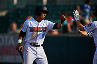 Inland Empire 66ers second baseman Jahmai Jones (8) is congratulated by teammates after scoring a run during a California League game against the Lancaster JetHawks at San Manuel Stadium on May 20, 2018 in San Bernardino, California. Inland Empire defeated Lancaster 12-2. (Zachary Lucy/Four Seam Images)