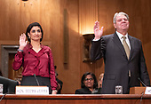 "Seema Verma, Administrator, Centers for Medicare & Medicaid Services, US Department of Health and Human Services, left, and, Eugene L. Dodaro, Comptroller General of the United States, US Government Accountability Office, right, are sworn-in prior to their giving testimony before the United States Senate Committee on Homeland Security & Governmental Affairs during a hearing entitled ""Examining CMS's Efforts to Fight Medicaid Fraud and Overpayments"" on Capitol Hill in Washington, DC on Tuesday, August 21, 2018.<br /> Credit: Ron Sachs / CNP"