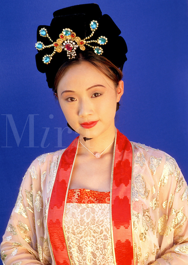Portrait of a Chinese woman in an ornate, antique Tang Dynasty silk dress and jeweled headdress.