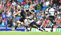 New Zealand's D J Forbes is tackled by Kenya's Oscar Ouma Achieng<br /> <br /> New Zealand Vs Kenya - men's quarter final<br /> <br /> Photographer Chris Vaughan/CameraSport<br /> <br /> 20th Commonwealth Games - Day 4 - Sunday 27th July 2014 - Rugby Sevens - Ibrox Stadium - Glasgow - UK<br /> <br /> © CameraSport - 43 Linden Ave. Countesthorpe. Leicester. England. LE8 5PG - Tel: +44 (0) 116 277 4147 - admin@camerasport.com - www.camerasport.com