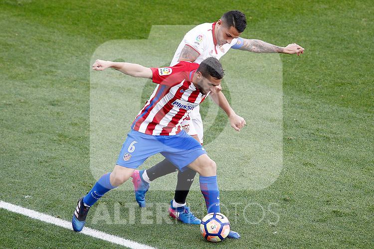 Atletico de Madrid's Koke Resurrecccion (l) and Sevilla FC's Vitolo during La Liga match. March 19,2017. (ALTERPHOTOS/Acero)