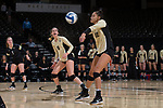 Kylie Long (12) of the Wake Forest Demon Deacons digs the ball against the USC Upstate Spartans in the LJVM Coliseum on September 9, 2017 in Winston-Salem, North Carolina.  The Demon Deacons defeated the Spartans 3-2.   (Brian Westerholt/Sports On Film)