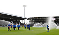 Bristol Rovers FC players have the sprinklers turned on them prior to the Carabao Cup match between Fulham and Bristol Rovers at Craven Cottage, London, England on 22 August 2017. Photo by Carlton Myrie.