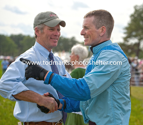 Trainer Doug Fout and jockey Jeff Murphy share a congratulatory moment after Maggie O. Bryant's Quiet Flaine takes the filly/mare finale.
