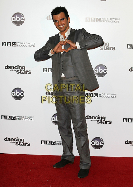 TONY DOVOLANI.'Dancing With The Stars' 200th Episode held at Boulevard 3, Hollywood, CA, USA..November 1st, 2010.full length white shirt wiastcoat grey gray suit hands.CAP/ADM/FS.©Faye Sadou/AdMedia/Capital Pictures.