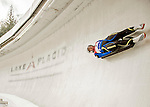 """5 December 2015: Olena Stetskiv, competing for Ukraine, slides through Curve 10 """"Shady"""" on her first run of the Viessmann World Cup Women's Luge at the Olympic Sports Track in Lake Placid, New York, USA. Mandatory Credit: Ed Wolfstein Photo *** RAW (NEF) Image File Available ***"""